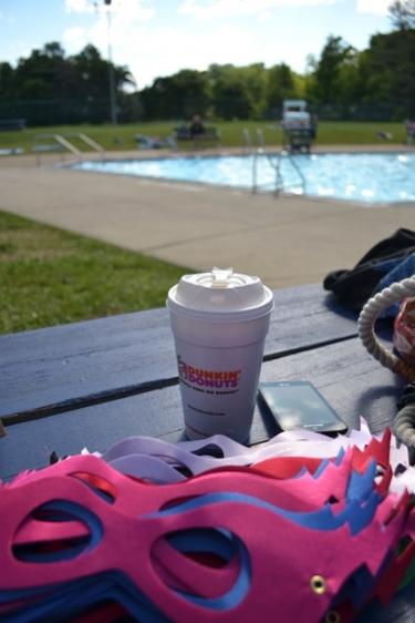 coffee cup, superhero mask and a pool