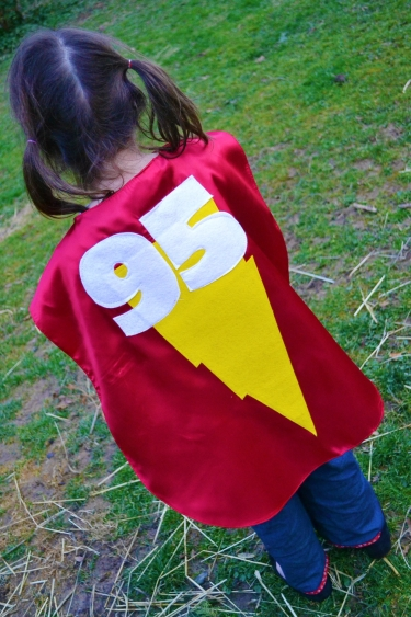 girl wearing a superhero cape