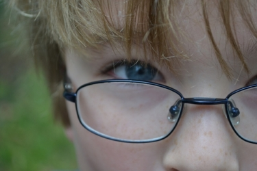 boys eye with glasses